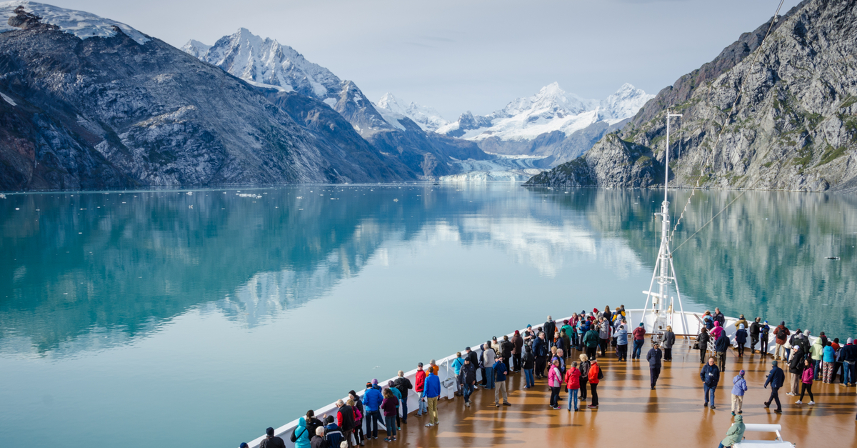 Shutterstock/ GLACIER BAY - ALASKA SEPTEMBER 11, 2016: Cruise ship passengers get a close-up view of the majestic glaciers as they sail in Glacier Bay National Park and Preserve in Southeast Alaska.