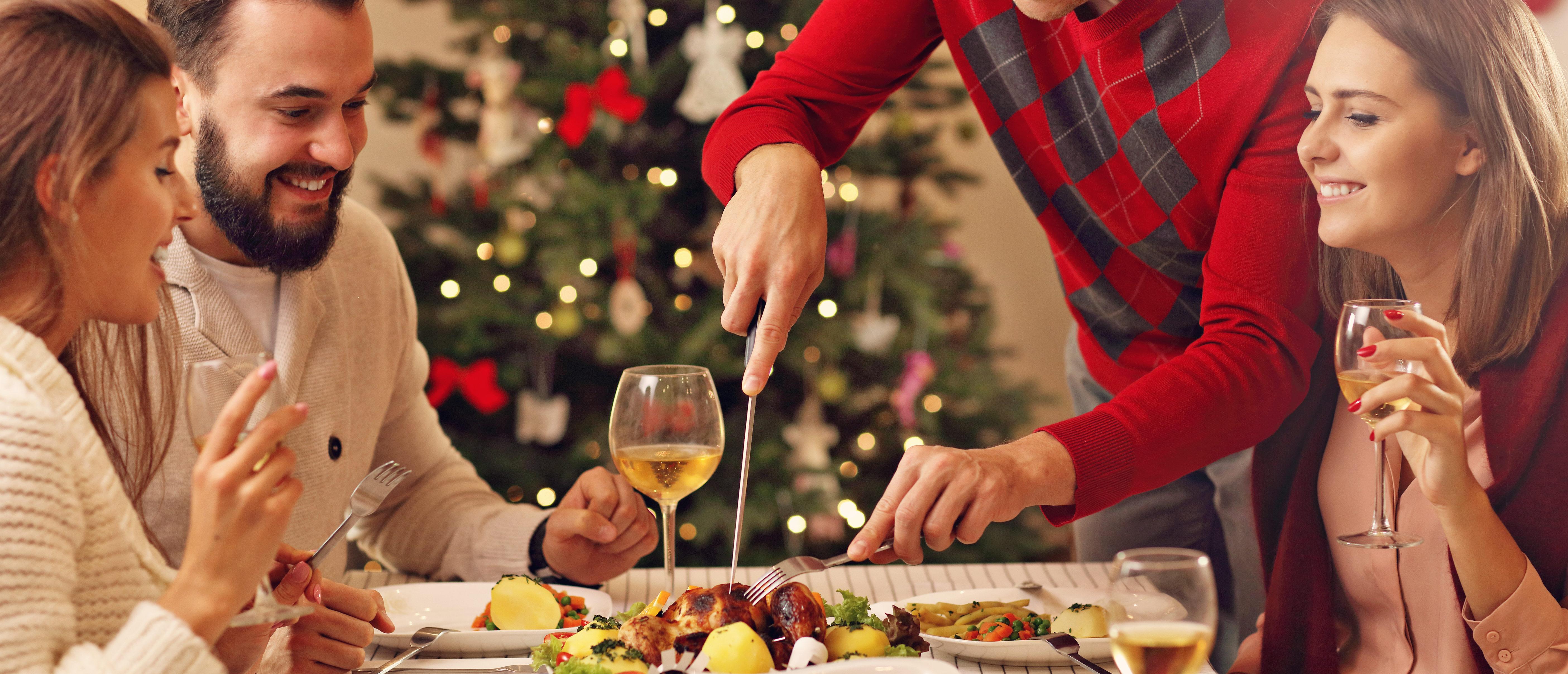 A family eats Christmas dinner. (Shutterstock/Kamil Macniack)