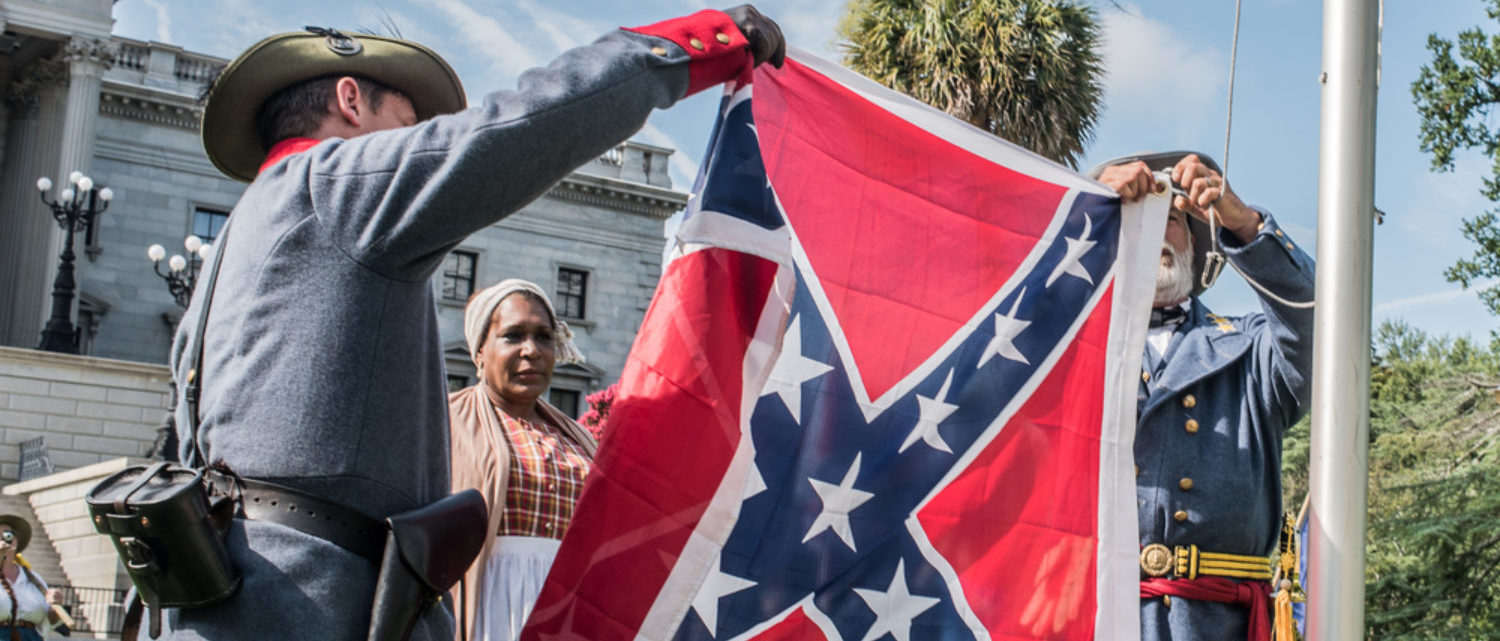Counter-protesters protest a flag raising event held in protest of the the Confederate flag's removal from the S.C. State House in 2015 (Shutterstock/Crush Rush)