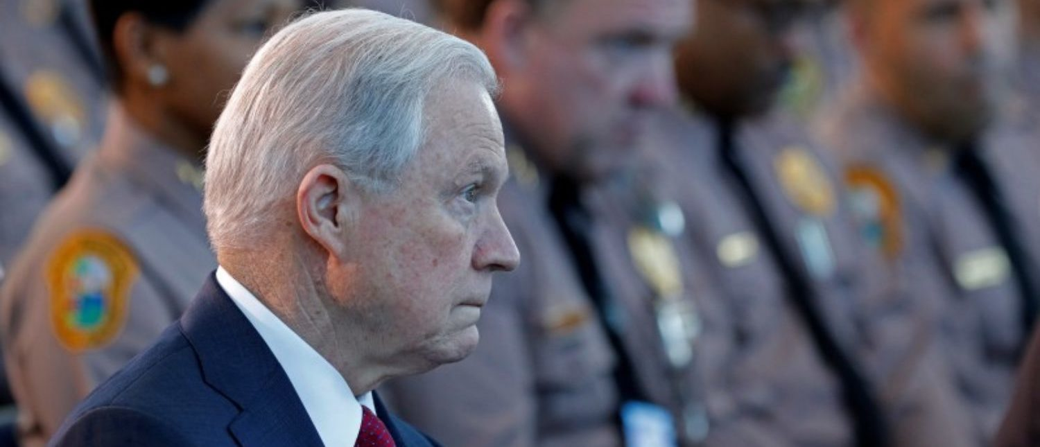 U.S. Attorney General Jeff Sessions (C) sits with guests before speaking on the growing trend of violent crime in sanctuary cities during an event on the Port of Miami in Miami, Florida, August 16, 2017. REUTERS/Joe Skipper