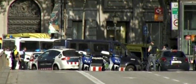 A still image from video shows a police cordon on a street in Barcelona, Spain following a van crash August 17, 2017. REUTERS TV via REUTERS