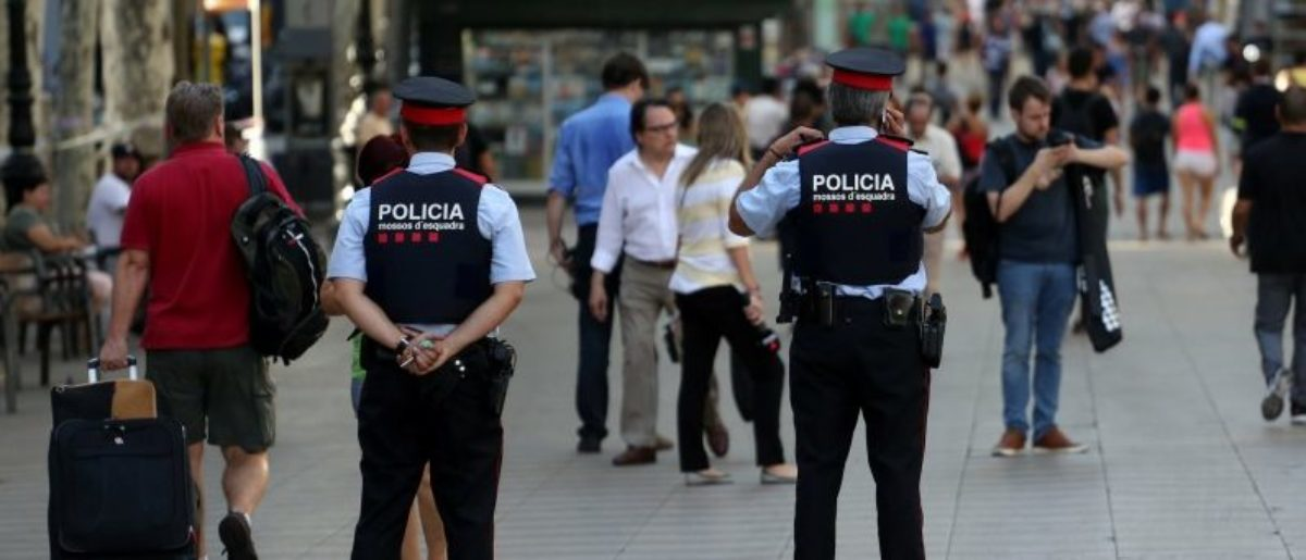 Catalan Mossos d'esquadra officers patrol at Las Ramblas street where a van crashed into pedestrians in Barcelona, Spain August 18, 2017. REUTERS/Sergio Perez