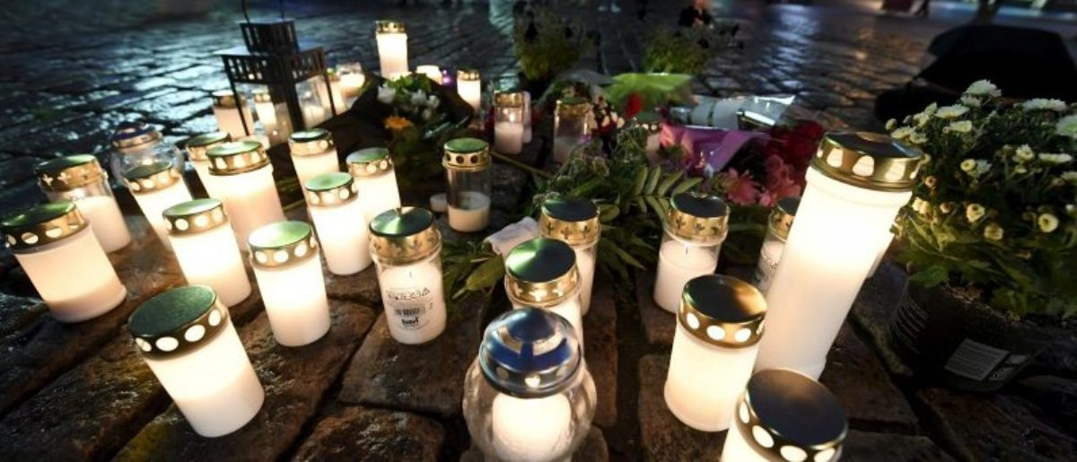 Candles at Turku Market Square for the victims of Friday's stabbings are pictured in Turku, Finland August 18, 2017.  LEHTIKUVA/Vesa Moilanen via REUTERS