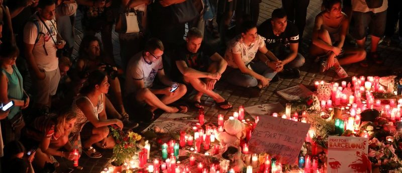 People gather around an impromptu memorial a day after a van crashed into pedestrians at Las Ramblas in Barcelona,  Spain August 18, 2017. REUTERS/Sergio Perez