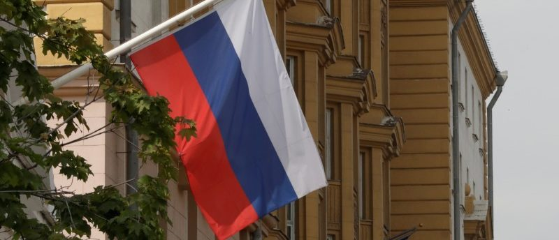 FILE PHOTO: A Russian flag flies in front of the U.S. embassy building in Moscow, Russia, July 28, 2017. REUTERS/Tatyana Makeyeva