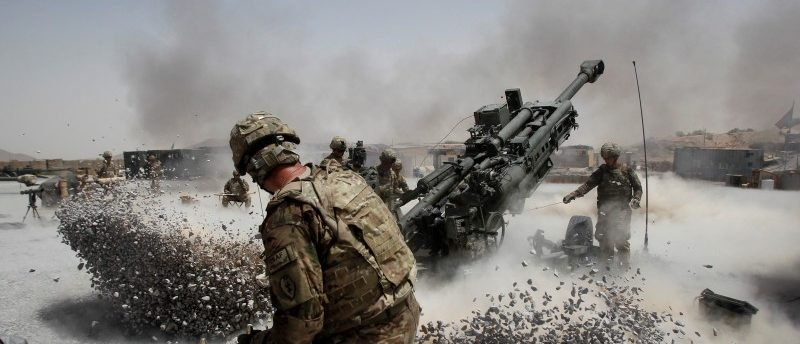 FILE PHOTO: U.S. Army soldiers from the 2nd Platoon, B battery 2-8 field artillery, fire a howitzer artillery piece at Seprwan Ghar forward fire base in Panjwai district, Kandahar province southern Afghanistan, June 12, 2011. REUTERS/Baz Ratner