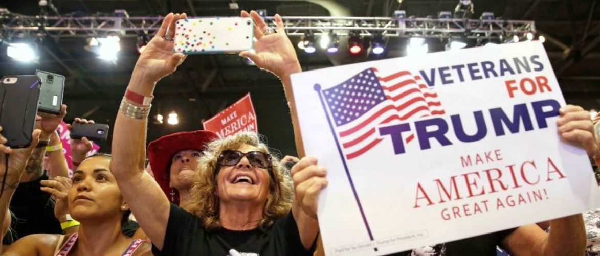 Supporters of U.S. President Donald Trump cheer him at a campaign rally in Phoenix, Arizona, U.S., August 22, 2017.   REUTERS/Joshua Roberts
