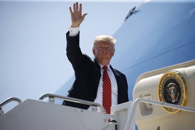 President Donald Trump waves to Marines as he departs Marine Corps Air Station Yuma in Yuma, Arizona. REUTERS/Joshua Roberts