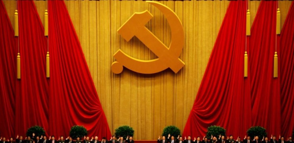 FILE PHOTO - A general view shows delegates raising their hands as they take a vote at the closing session of the 18th National Congress of the Communist Party of China at the Great Hall of the People in Beijing November 14, 2012. REUTERS/Carlos Barria/File Photo