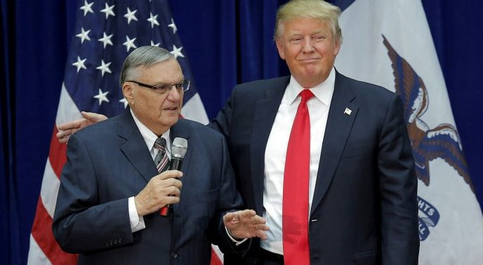 Republican presidential candidate Donald Trump is joined onstage by Maricopa County Sheriff Joe Arpaio at a campaign rally in Marshalltown, Iowa, U.S. on January 26, 2016, after Arpaio endorsed Trump. REUTERS/Brian Snyder/File Photo