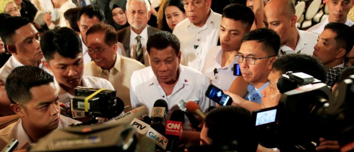 FILE PHOTO - Philippine President Rodrigo Duterte is interviewed by reporters after the handover of a draft law of the Bangsamoro Basic Law (BBL) in a ceremony at the Malacanang presidential palace in metro Manila, Philippines July 17, 2017. REUTERS/Romeo Ranoco/File Photo