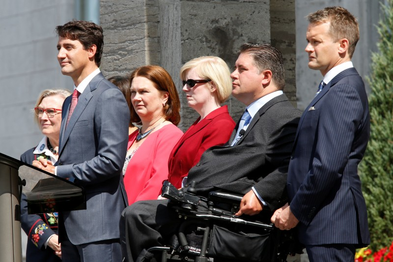 Canada's Prime Minister Justin Trudeau (2nd L) takes part in a news conference with Minister of Crown-Indigenous Relations and Northern Affairs Carolyn Bennett (L), Minister of Indigenous Services Jane Philpott (3rd L), Minister of Public Works Carla Qualtrough (3rd R), Minister of Sport and Persons with Disabilities Kent Hehr (2nd R) and Minister of Veterans Affairs and Associate Minister of National Defence Seamus O'Reagan following a cabinet shuffle at Rideau Hall in Ottawa, Ontario, Canada, August 28, 2017. REUTERS/Chris Wattie