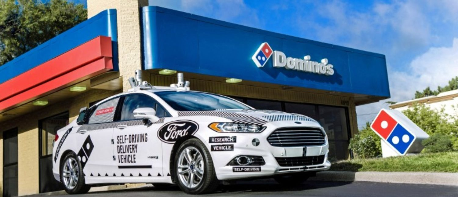 A Ford self-driving delivery vehicle is pictured in front of a Domino's pizza restaurant. Ford Motor Company/Handout via REUTERS