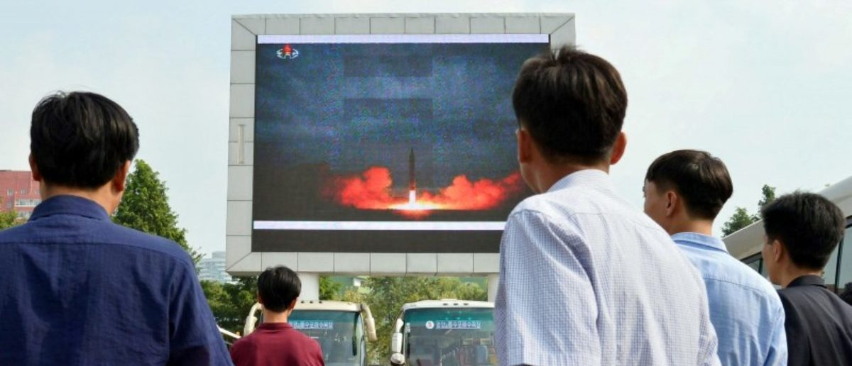 North Koreans watch a news report showing North Korea's Hwasong-12 intermediate-range ballistic missile launch on electronic screen at Pyongyang station in Pyongyang, North Korea, in this photo taken by Kyodo August 30, 2017. Mandatory credit Kyodo/via REUTERS
