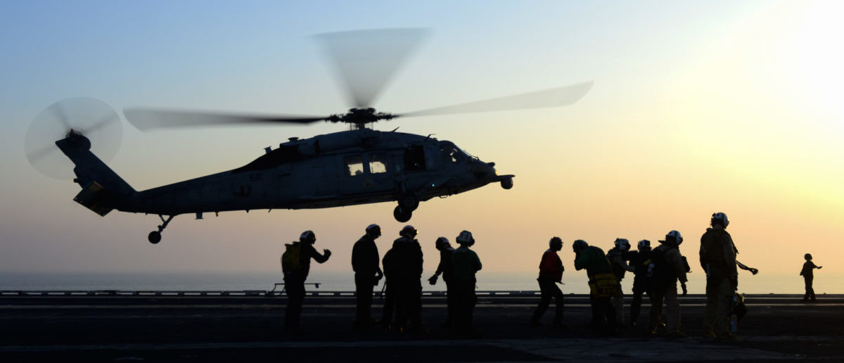 "ARABIAN GULF (Aug. 9, 2017) An MH-60S Sea Hawk helicopter assigned to the ""Eightballers"" of Helicopter Sea Combat Squadron (HSC) 8 prepares to land aboard the aircraft carrier USS Nimitz (CVN 68) in the Arabian Gulf. Nimitz is deployed in the U.S. 5th Fleet area of operations in support of Operation Inherent Resolve. While in this region, the ship and its carrier strike group are conducting maritime security operations to reassure allies and partners, preserve freedom of navigation, and maintain the free flow of commerce. (U.S. Navy photo by Mass Communication Specialist 3rd Class Leon Wong/Released)"