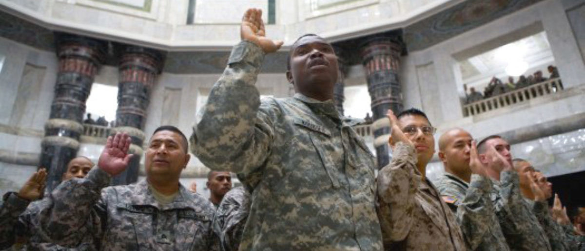 U.S. servicemembers take the citizenship oath inside Al-Faw palace at Camp Victory, Iraq, July 4, 2009.