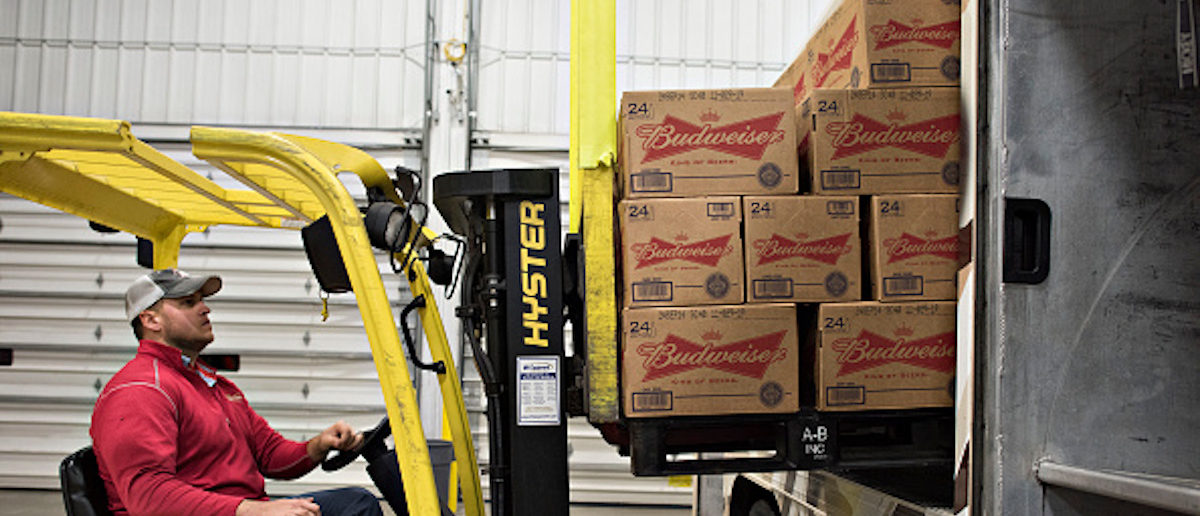 Cases of Anheuser-Busch beer are loaded into a delivery truck at Brewers Distributing Co. in Peoria, Illinois, U.S., on Thursday, Oct. 30, 2014. Anheuser-Busch Inbev NV is scheduled to report third-quarter earnings on Oct. 31. Photographer: Daniel Acker/Bloomberg via Getty Images