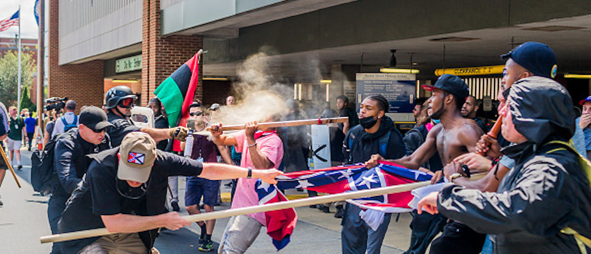 """CHARLOTTESVILLE, VIRGINIA, UNITED STATES - 2017/08/12: On Saturday, August 12, 2017, a veritable who's who of white supremacist groups clashed with hundreds of counter-protesters during the """"Unite The Right"""" rally in Charlottesville, Va. Dozens were injured in skirmishes and many others after a white nationalist plowed his sports car into a throng of protesters.  One counter-protester died after being struck by the vehicle. The driver of the car was caught fleeing the scene and the Governor of Virginia issued a state of emergency. (Photo by Michael Nigro/Pacific Press/LightRocket via Getty Images)"""