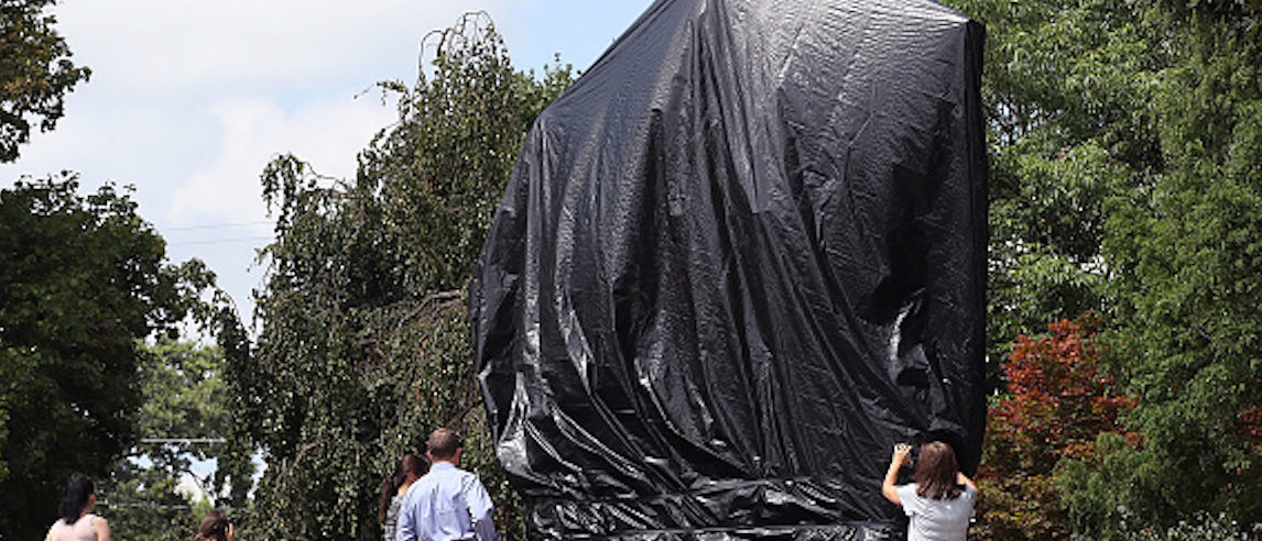 CHARLOTTESVILLE, VA - AUGUST 23: The statue of Confederate Gen. Robert E. Lee is covered with a black tarp as it stands in the center of Emancipation Park, formerly Lee Park, on August 23, 2017 in Charlottesville, Virginia. Earlier this week the Charlottesville city council voted unanimously to cover Confederate statues in black tarp. (Photo by Mark Wilson/Getty Images)
