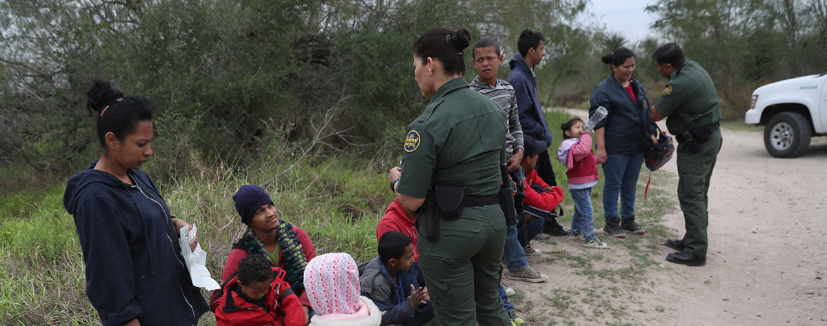 U.S. Border Patrol agents take Central American immigrants into custody on January 4, 2017 near McAllen, Texas. Thousands of families and unaccompanied children, most from Central America, are crossing the border illegally to request asylum in the U.S. from violence and poverty in their home countries. The number of immigrants coming across has surged in advance of President-elect Donald Trump's inauguration January 20. He has pledged to build a wall along the U.S.-Mexico border. (Photo by John Moore/Getty Images)