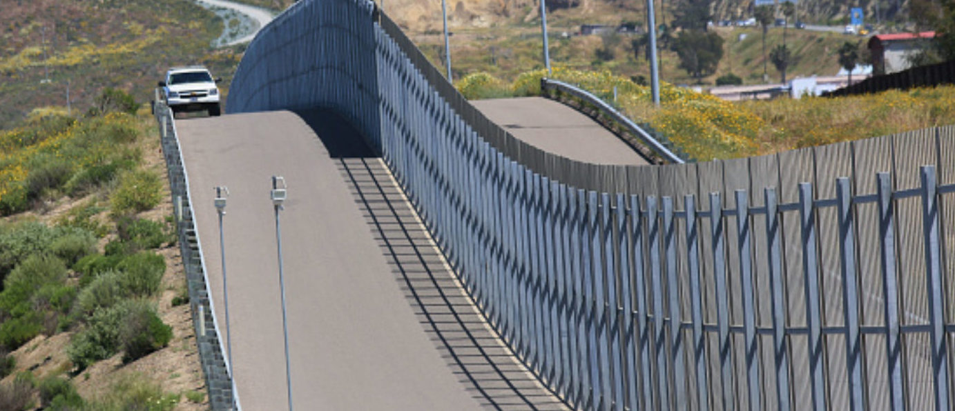 Border Patrol agents patrol the US-Mexico border prior to an Easter mass at the fence separating the two countries at Friendship Park in San Ysidro, California on Sunday, April 16, 2017. / AFP PHOTO / Sandy Huffaker (Photo credit should read SANDY HUFFAKER/AFP/Getty Images)