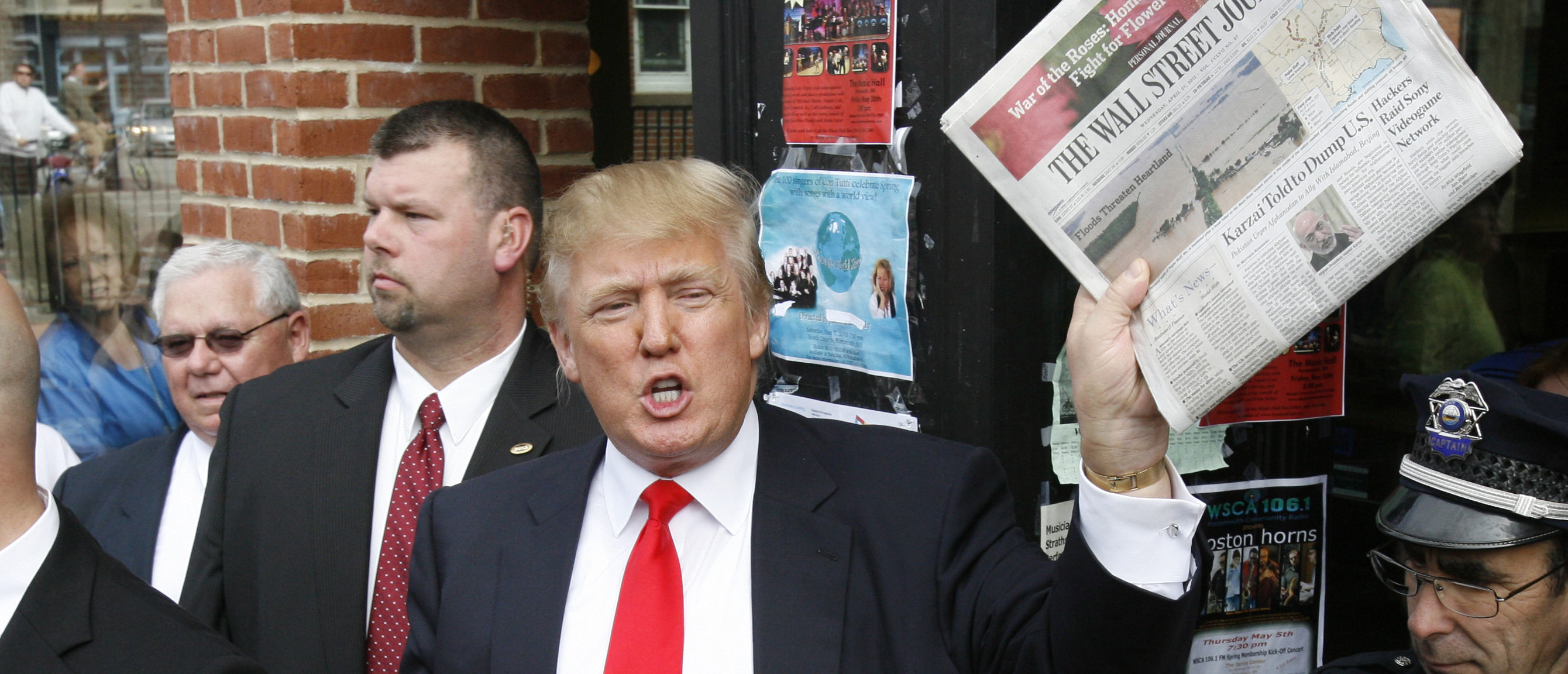 FILE -- Donald Trump holds up a newspaper as he makes a reference to a story in it while walking through downtown Portsmouth, New Hampshire April 27, 2011. REUTERS/Joel Page