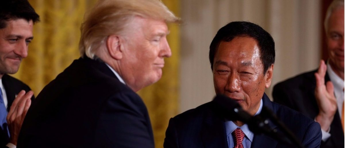 Foxconn Chairman Terry Gou shakes hands with President Donald Trump July 26, 2017. REUTERS/Jonathan Ernst.