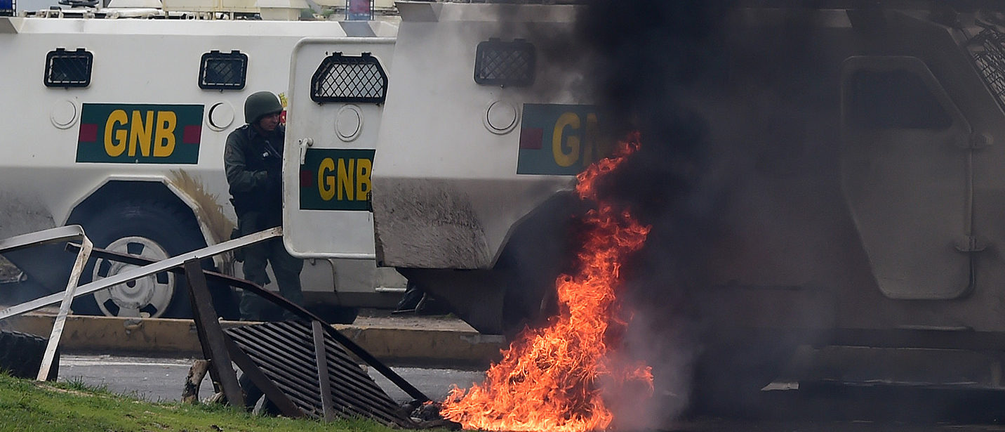 """In the video posted online earlier, allegedly at an army base used by the National Bolivarian Armed Forces in Valencia, a man presenting himself as an army captain declared a """"legitimate rebellion... to reject the murderous tyranny of Nicolas Maduro"""" and demanded a transitional government and """"free elections."""" After the video surfaced, military chiefs said troops had put down the """"terrorist"""" attack. PHOTO: Getty Images/AFP/Ronaldo SCHEMIDT)"""