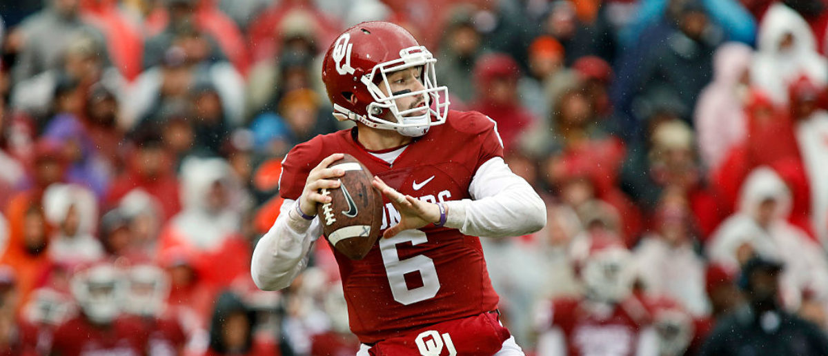 Quarterback Baker Mayfield #6 of the Oklahoma Sooners looks to throw during the game against the Oklahoma State Cowboys December 3, 2016 at Gaylord Family-Oklahoma Memorial Stadium in Norman, Oklahoma. (Photo by Brett Deering/Getty Images)