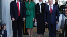 First lady Melania Trump welcomes King Abdullah II of Jordan and his wife Queen Rania of Jordan at the West Wing of the White House, on April 5, 2017 in Washington, DC. in a emerald green dress.  (Photo by Mark Wilson/Getty Images)