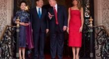 US First Lady Melania Trump (R) and President Donald Trump (2nd R) pose with Chinese President Xi Jinping (2nd L) and his wife Peng Liyuan (L) upon their arrival to the Mar-a-Lago estate in West Palm Beach, Florida, on April 6, 2017. / AFP PHOTO / JIM WATSON        (Photo credit should read JIM WATSON/AFP/Getty Images)