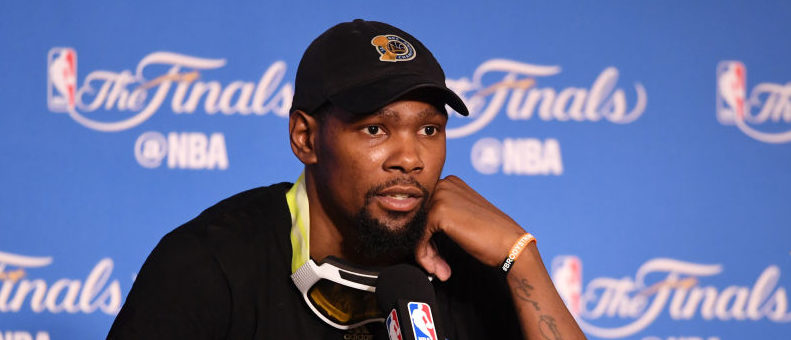 Kevin Durant #35 of the Golden State Warriors speaks at the press conference after his teams 129-120 victory over the Cleveland Cavaliers in Game 5 to win the 2017 NBA Finals at ORACLE Arena on June 12, 2017 in Oakland, California. NOTE TO USER: User expressly acknowledges and agrees that, by downloading and or using this photograph, User is consenting to the terms and conditions of the Getty Images License Agreement. (Photo by Thearon W. Henderson/Getty Images)