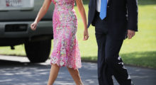Melania Trump walks across the South Lawn before departing the White House July 25, 2017 in Washington, DC for a 'Make America Great Again' rally in a pink floral dress.  (Photo by Chip Somodevilla/Getty Images)