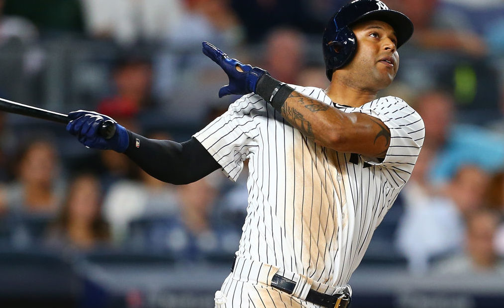 Aaron Hicks #31 of the New York Yankees connects on a 2-run home run in the eighth inning against the Boston Red Sox at Yankee Stadium on August 11, 2017 in the Bronx borough of New York City. (Photo by Mike Stobe/Getty Images)