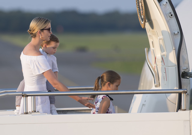 Ivanka Trump, daughter of US President Donald Trump, along with her children, Arabella (L) and Theodore, board Air Force One prior to departure Morristown Municipal Airport in Morristown, New Jersey, August 20, 2017, as Trump returns to Washington, DC, following a 17-day vacation at his property in Bedminster, New Jersey. / AFP PHOTO / SAUL LOEB (Photo credit should read SAUL LOEB/AFP/Getty Images)