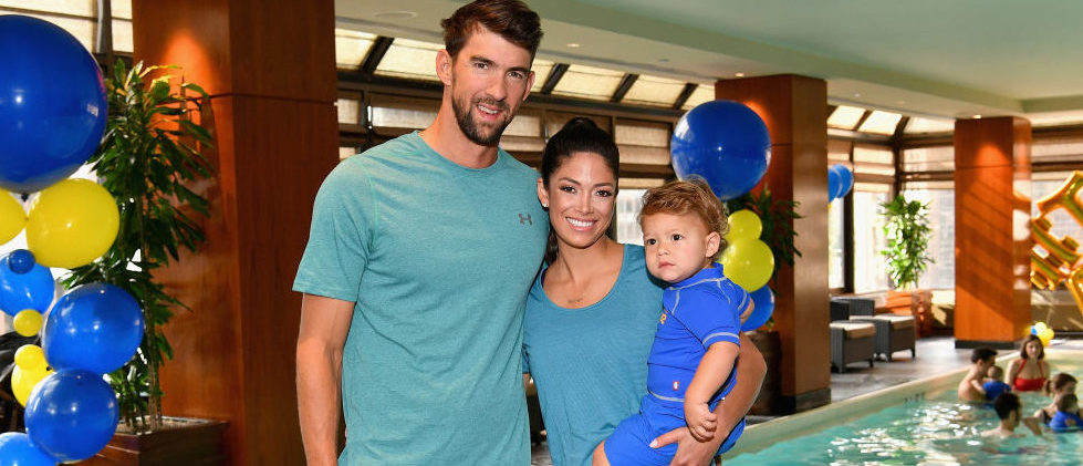 Michael Phelps, Nicole Phelps and their son attend the Huggies Little Swimmers Swim Class on August 21, 2017 in New York City. (Photo Credit: Getty Images)