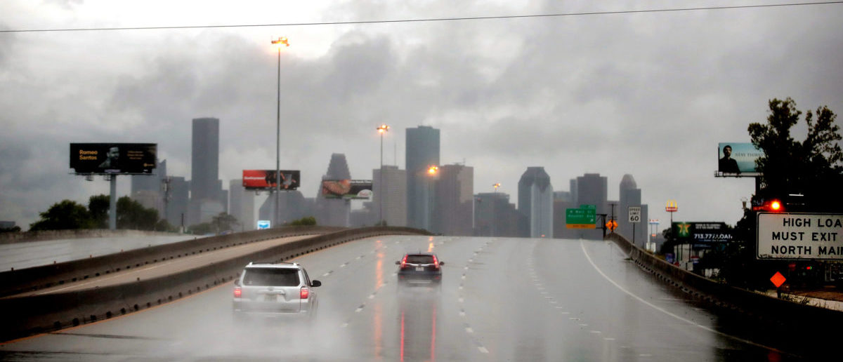 Rain from Hurricane Harvey batters the downtown area on August 26, 2017 in Houston, Texas. Harvey, which made landfall north of Corpus Christi late last night, is expected to dump upwards to 40 inches of rain in Texas over the next couple of days. (Photo by Scott Olson/Getty Images)