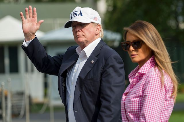 US President Donald Trump and First Lady Melanie Trump walk from Marine One upon arrival on the South Lawn of the White House in Washington, DC, August 27, 2017, after spending the weekend at Camp David, the Presidential retreat in Maryland. / AFP PHOTO / SAUL LOEB (Photo credit should read SAUL LOEB/AFP/Getty Images)