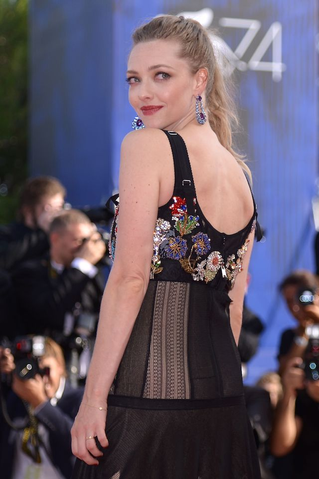 """Actress Amanda Seyfried arrives for the premiere of the movie """"First Reformed"""" presented in competition at the 74th Venice Film Festival on August 31, 2017 at Venice Lido. (Photo credit: FILIPPO MONTEFORTE/AFP/Getty Images)"""