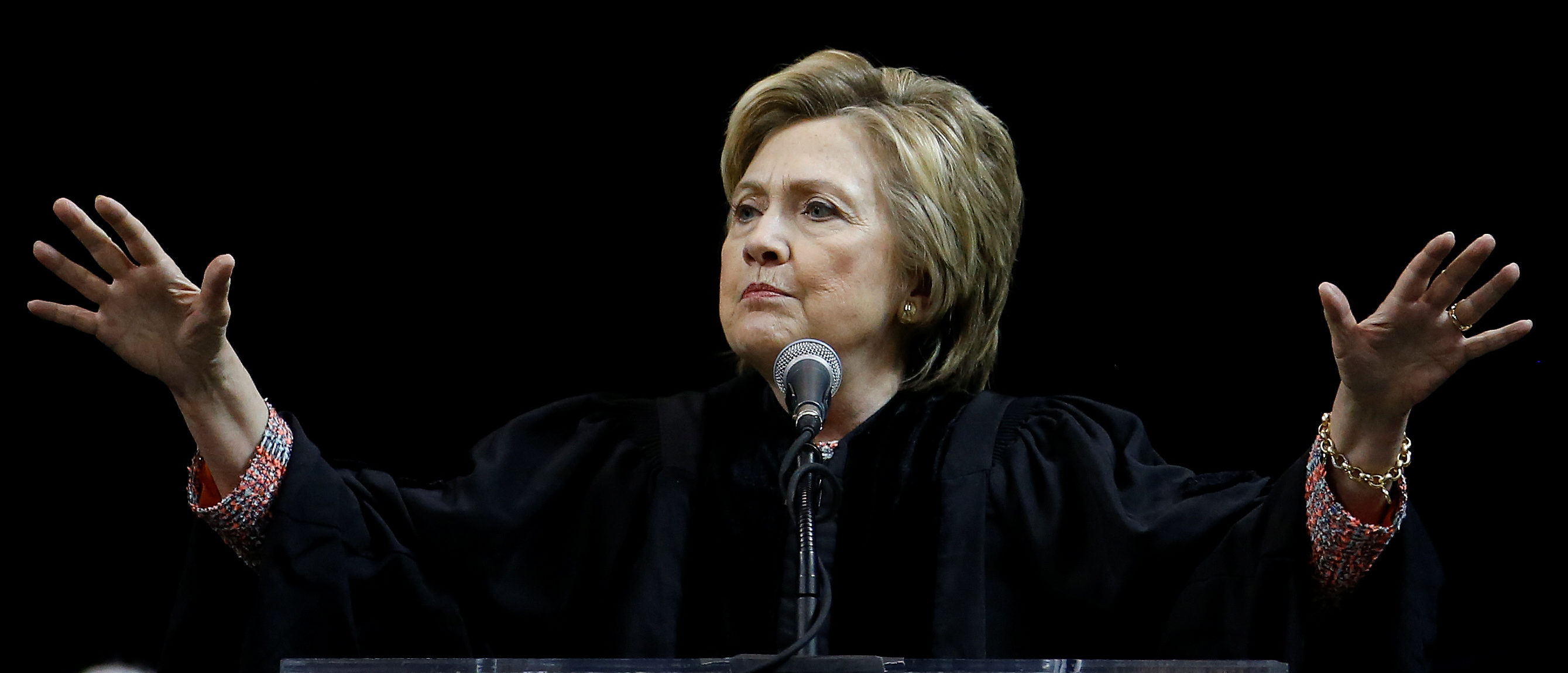 Former Secretary of State Hillary Clinton speaks on stage during a commencement for Medgar Evers College in the Brooklyn borough of New York City, New York, U.S. June 8, 2017. REUTERS/Carlo Allegri - RTX39OMC