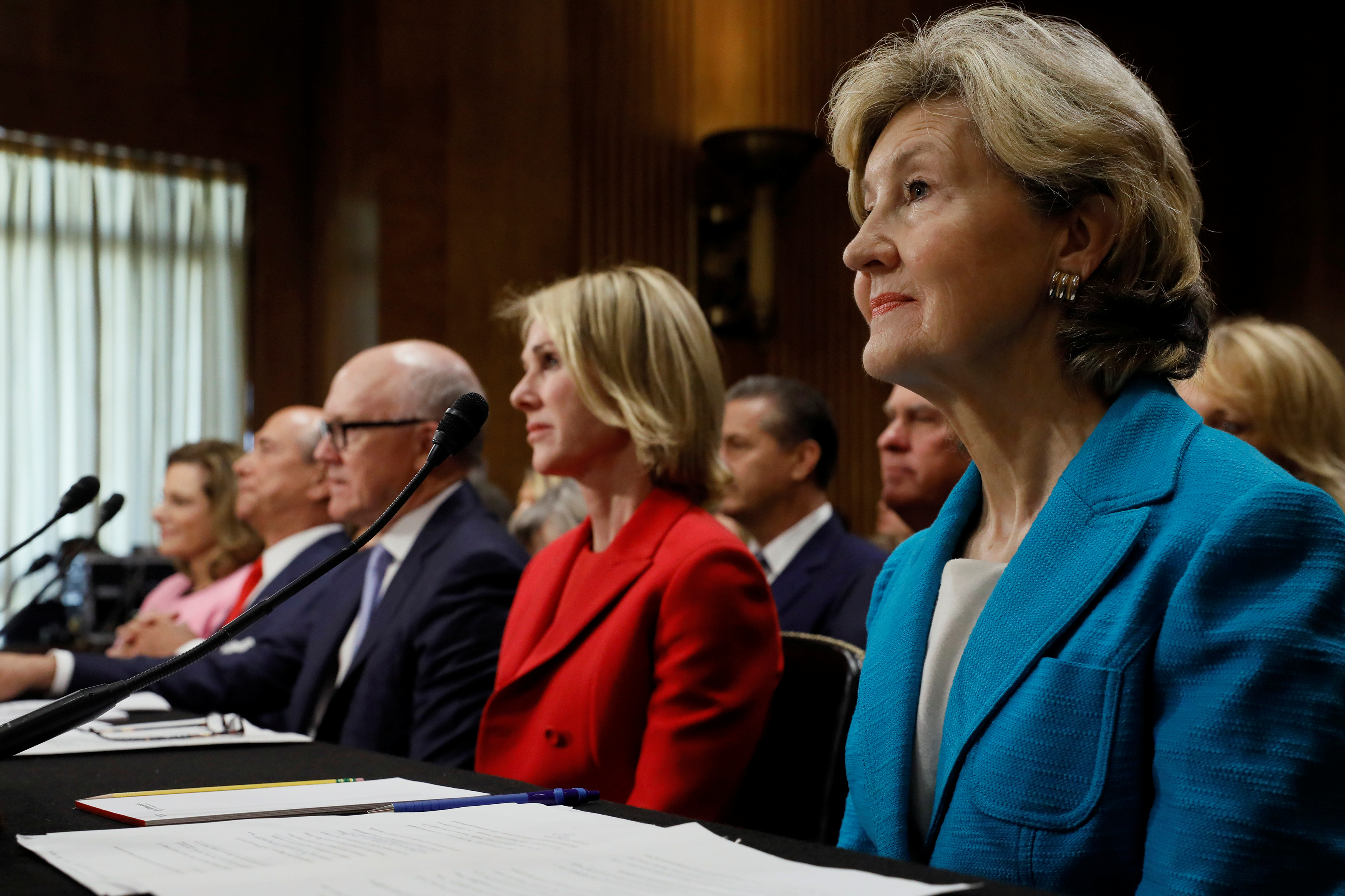 """U.S. President Donald Trump's nominee for ambassador to NATO Kay Bailey Hutchison (R), flanked by (L-R) nominee for ambassador to Singapore K.T. McFarland, nominee for ambassador to Italy Lewis Eisenberg, nominee for ambassador to Great Britain Robert Wood """"Woody"""" Johnson and nominee for ambassador to Canada Kelly Knight Craft, testifies at the Senate Foreign Relations Committee hearing on their nominations on Capitol Hill in Washington, U.S. July 20, 2017. REUTERS/Jonathan Ernst - RTX3C90X"""