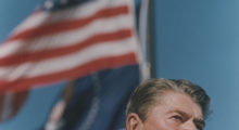 """Ronald Reagan's sound check joke, """"My fellow Americans, I'm pleased to tell you today that I've signed legislation that will outlaw Russia forever. We begin bombing in five minutes,"""" sparked the birth of National Presidential Joke Day (REUTERS/Gary Cameron)"""