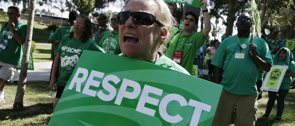 AFSCME sign: REUTERS/Jonathan Alcorn