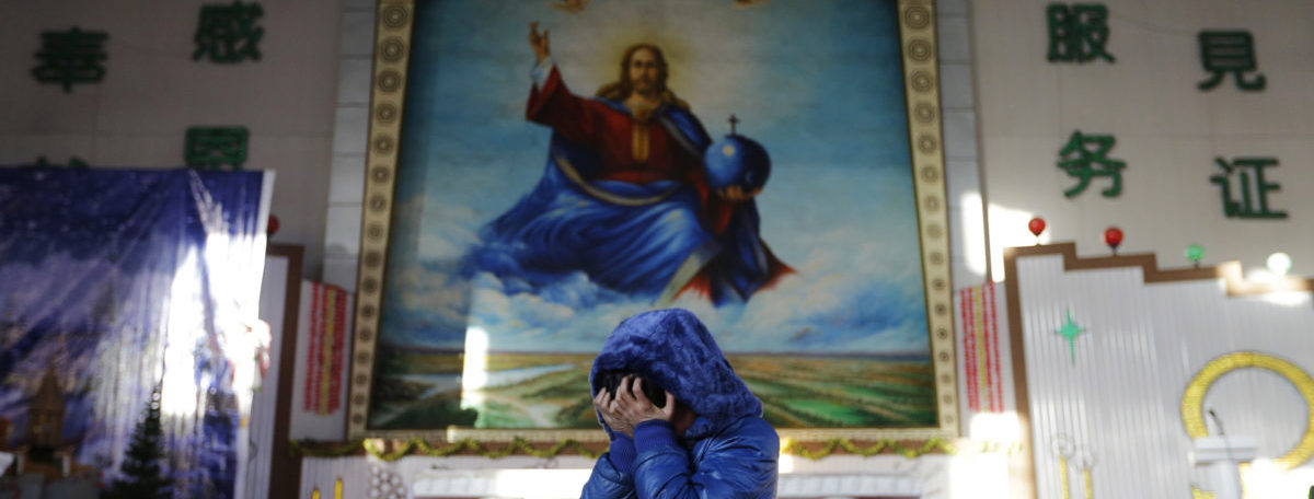 A student cries and covers her face with her hands after telling her Christmas story ahead of a mass at the Catholic church in Xiliulin village near the city of Taiyuan, Shanxi province, December 23, 2012. REUTERS/Jason Lee (CHINA - Tags: RELIGION SOCIETY) - RTR3BV0U