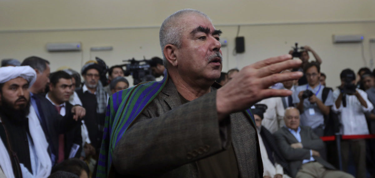 Abdul Rashid Dostum, an Uzbek leader and a vice-presidential candidate, talks with his supporters at the Afghanistan's Independent Election Commission (IEC) in Kabul October 6, 2013. Three men considered as front runners in Afghanistan's presidential election staged dramatic last-minute nominations on Sunday, the start of what is expected to be a chaotic but critical race for the palace in the first democratic transfer of power. REUTERS/Omar Sobhani (AFGHANISTAN - Tags: ELECTIONS POLITICS) - RTR3FNQI