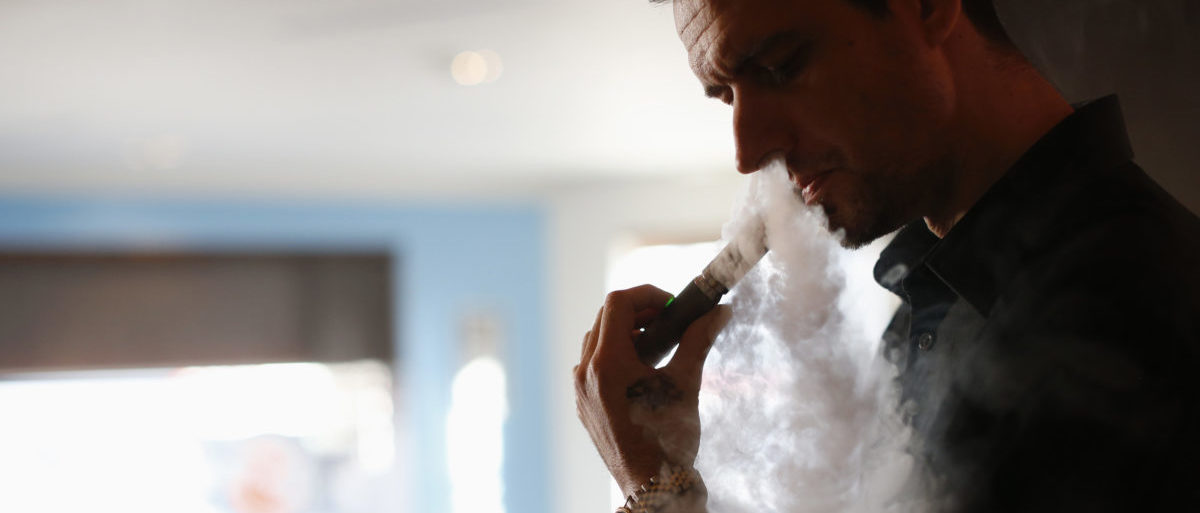 Enthusiast Damien Hoops uses an electronic cigarette at The Vapor Spot vapor bar in Los Angeles, California March 4, 2014. REUTERS/Mario Anzuoni