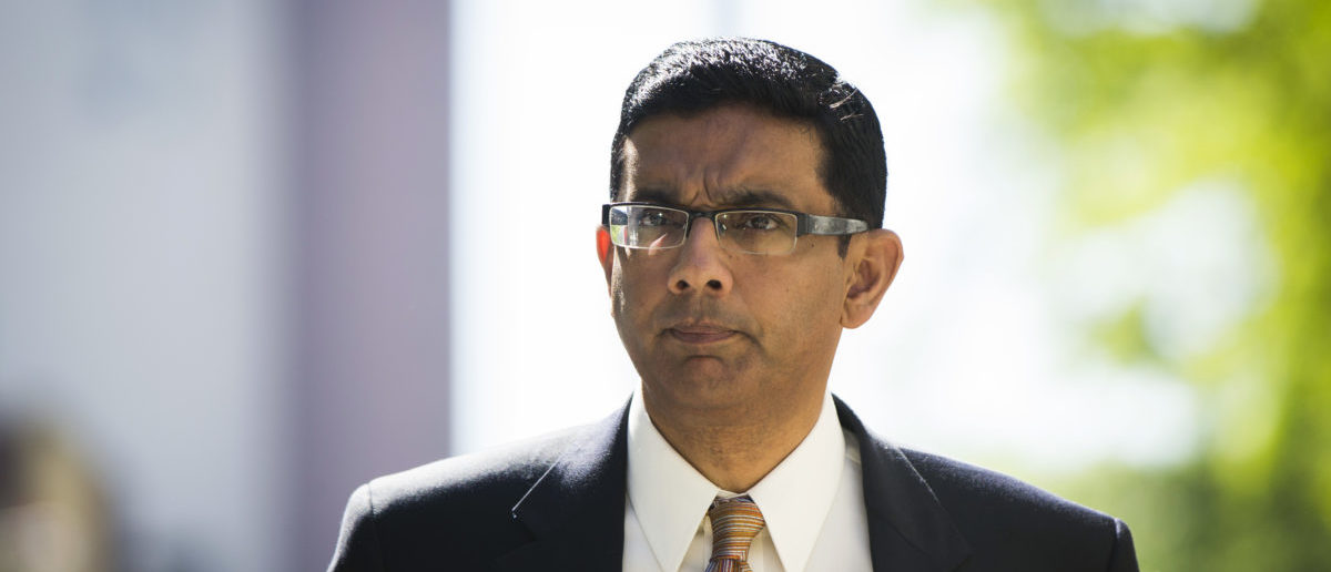 Dinesh D'Souza exits the Manhattan Federal Courthouse after pleading guilty in New York, May 20, 2014. REUTERS/Lucas Jackson