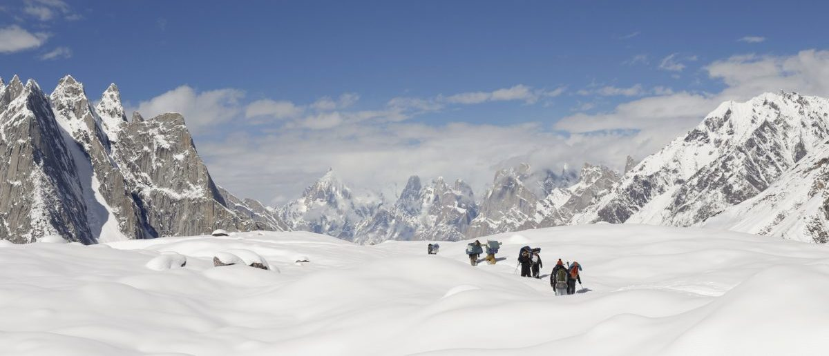 Trekkers and porters hike down the Baltoro glacier in the Karakoram mountain range in Pakistan
