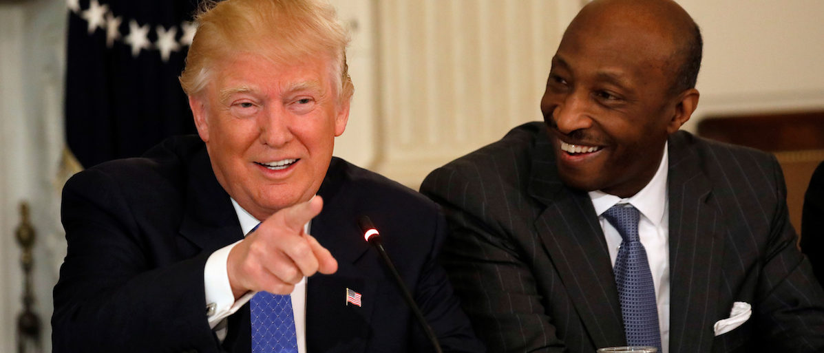 Merck & Co. CEO Ken Frazier (R) listens to U.S. President Donald Trump speak during a meeting with manufacturing CEOs at the White House in Washington, DC, U.S. February 23, 2017. REUTERS/Kevin Lamarque - RTS100JV
