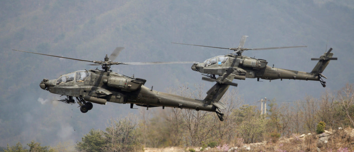 U.S. Army's AH-64 Apache helicopters fire, during a U.S.-South Korea joint live-fire military exercise, at a training field, near the demilitarized zone, separating the two Koreas in Pocheon, South Korea April 21, 2017. Picture taken on April 21, 2017. REUTERS/Kim Hong-Ji